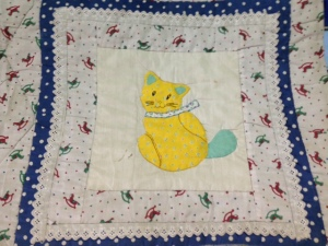 Cat patchwork on ABC quilt